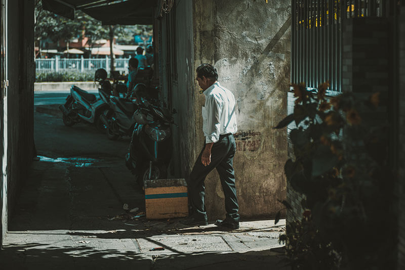 man walking in Saigon Alley